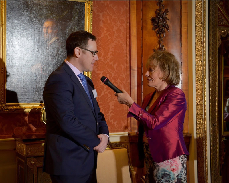 Sean Parry and Dame Esther Rantzen speaking at ChildLine event at Buckingham Palace