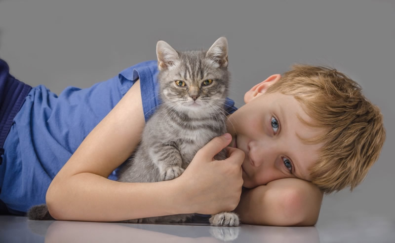 Foster child with foster family cat