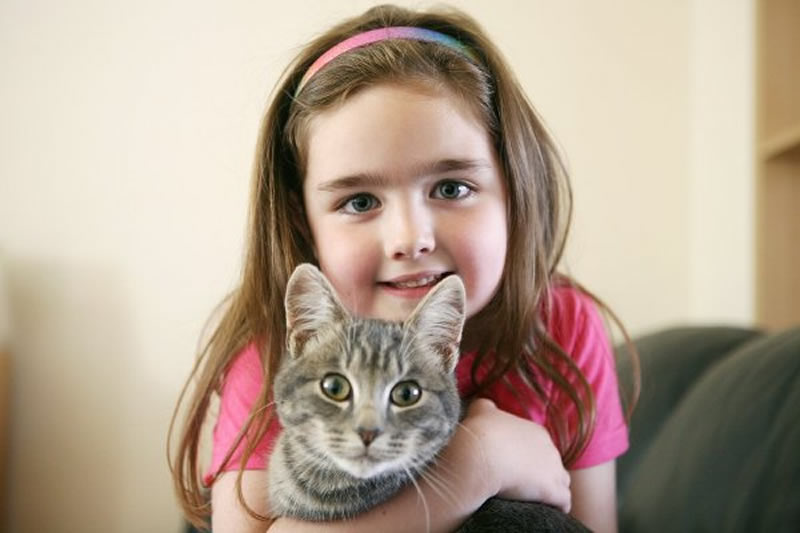 young foster girl with cat